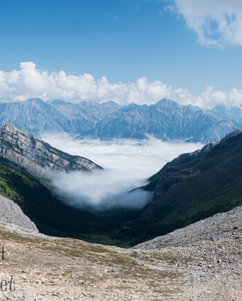 Mountain landscape with fog in valley and clouds in sky, Banff National Park landscape scenery
