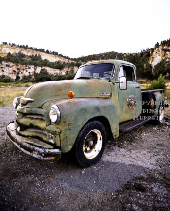 Front corner view of old rusted chevy pickup truck