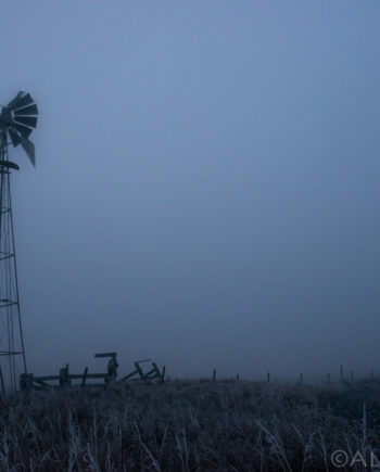 Old windmill in field with thick fog and frost, Alberta landscape