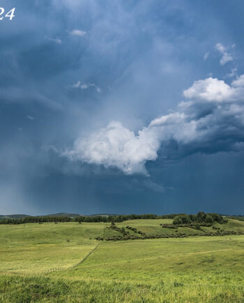 Alberta landscape, large thunderstown with rainbow and farm fieldAlberta landscape, large thunderstown with rainbow and farmland